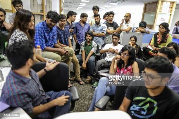 Employees gather at a storyboard meeting for the BYJU'S learning application in the Think and Learn Pvt office in Bengaluru India on Wednesday April...