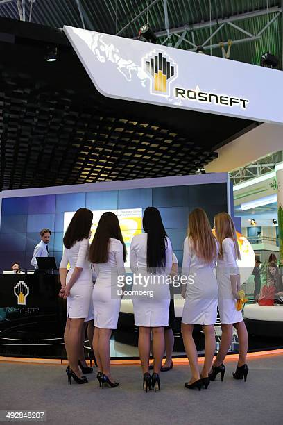 Employees gather for a morning briefing at the OAO Rosneft pavilion on the opening day of the St Petersburg International Economic Forum in Saint...