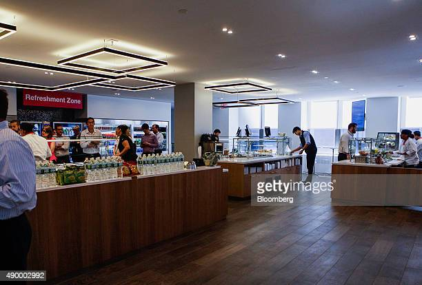 Employees get food during lunch in the cafeteria of the Societe Generale SA office in New York US on Monday Sept 14 2015 Many of Wall Street's...