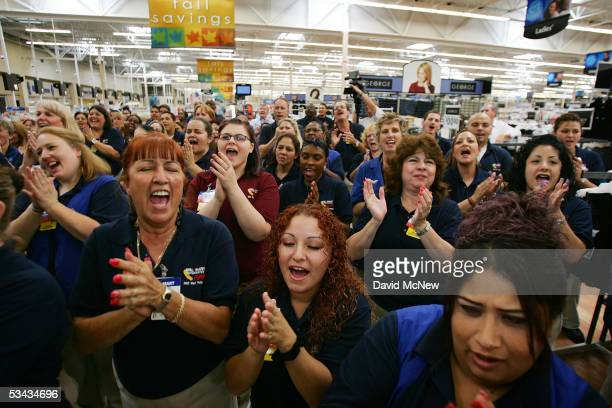 Employees give the WalMart cheer during their daily staff meeting at the soontobeopened WalMart Palmdale Supercenter department store on August 18...