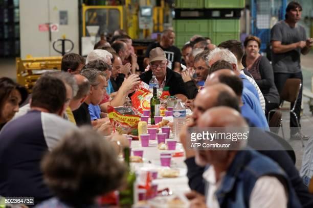 Employees have dinner as they occupy the plant of the GMS company on June 27 2017 in La Souterraine central France to call for a plan to rescue the...
