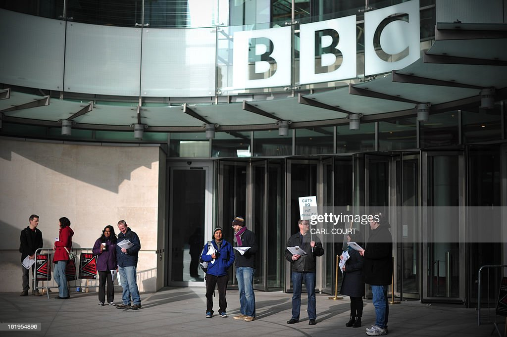 BBC employees hold placards outside Broadcasting House in central London on February 18 as they man a picket line during a strike over compulsory...