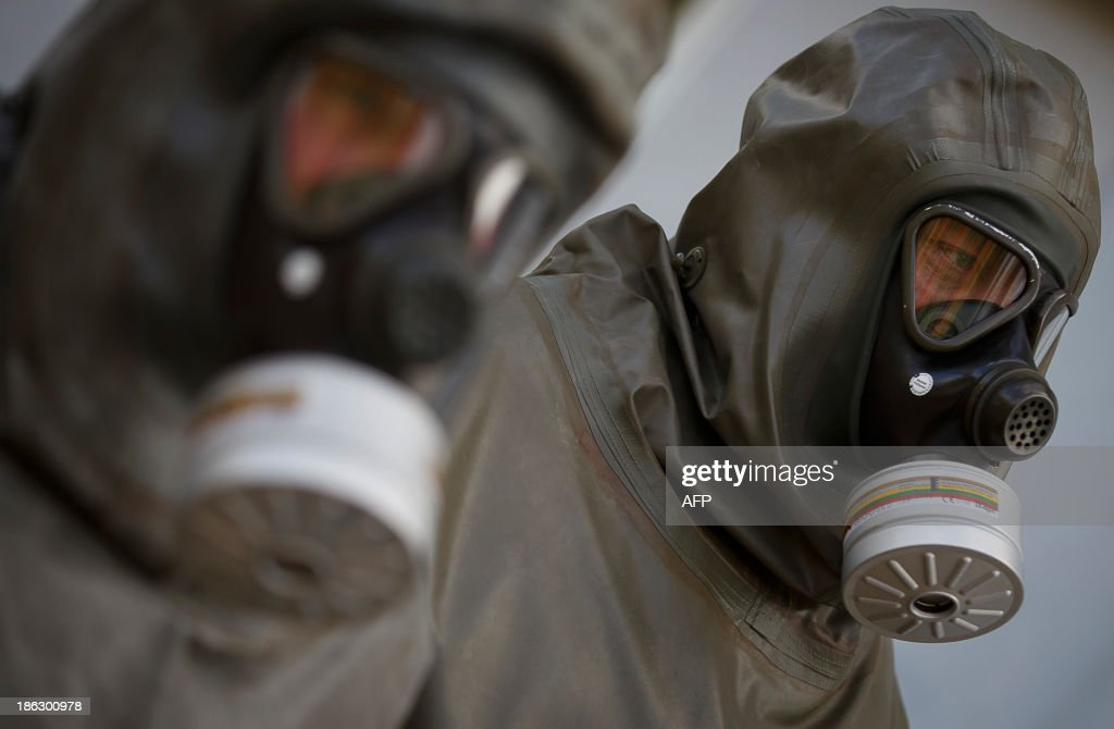 Employees in protective gear are seen during a demonstration in a chemical weapons disposal facility at GEKA (Gesellschaft zur Entsorgung von chemischen Kampfstoffen und Ruestungsaltlasten) in Munster, northern Germany, on October 30, 2013. The state-owned GEKA is a reference laboratory for the Organsation for the Prohibition of Chemical Weapons GUELLAND