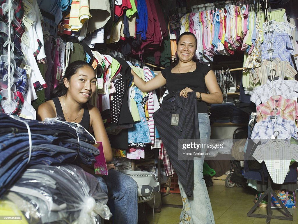 Employees in small town clothing store : Stock Photo
