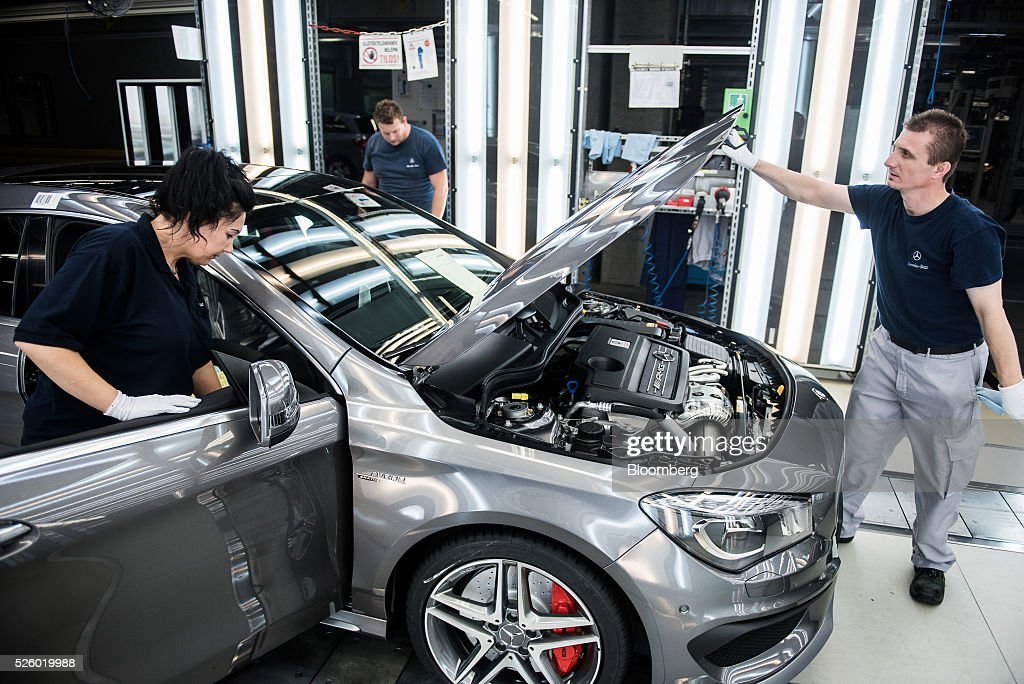 Employees inspect a CLA-class AMG automobile on the production line at the Mercedes-Benz AG automobile plant, operated by Daimler AG, in Kecskemet, Hungary, on Friday, April 29, 2016. Daimler's Mercedes factory will produce a new generation of compact vehicles, totaling Daimler's investment in Hungary to more than $1.8 billion. Photographer: Akos Stiller/Bloomberg via Getty Images