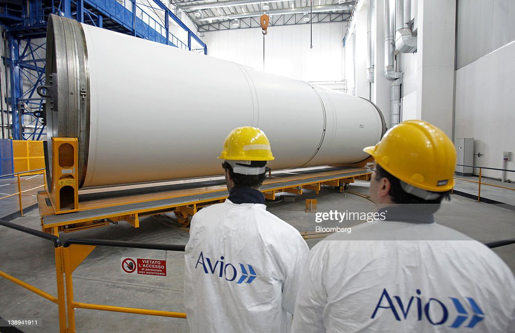 Employees inspect an Avio SpA Ariane 5 space rocket booster segment at the company's production plant in Colleferro, near Rome, Italy, on Monday, Feb. 13, 2012. Avio, an Italian provider of aerospace services and equipment including gearboxes for aircraft engines, aims to sell shares to the public when the market improves, Chief Executive Officer Francesco Caio said in an interview. Photographer: Alessia Pierdomenico/Bloomberg via Getty Images