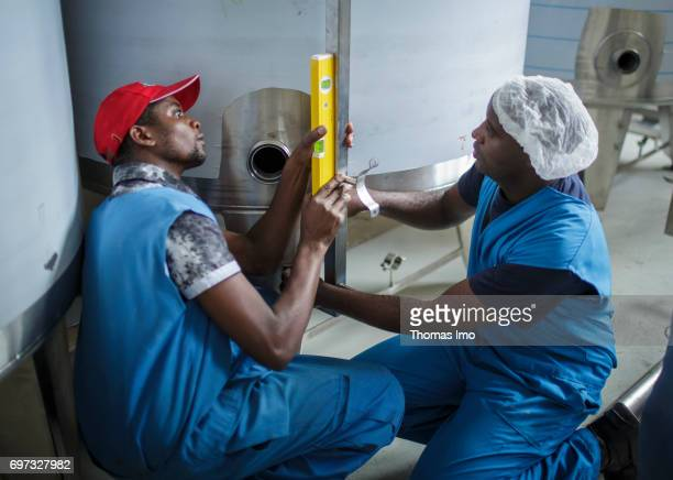 Employees install a technical plant at beverage manufacturer Kevian Kenya Ltd on May 18 2017 in Thika Kenya