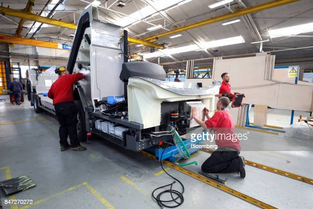 Employees install components to an Enviro 400 bus at the Alexander Dennis Ltd factory in Scarborough UK on Wednesday Sept 13 2017 Manufacturing in...