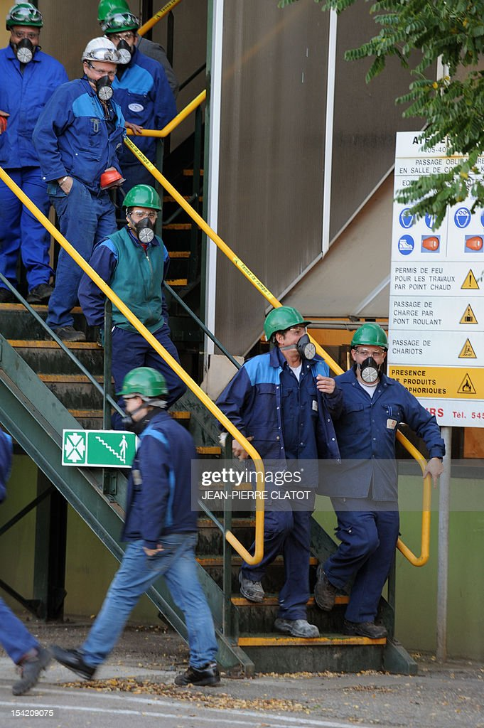 Employees leave their working place during a security exercice in Jarrie, southeastern France inside the Jarrie site of CEZUS, an AREVA group subsidiary and a global leader in the market for nuclear-grade zirconium. Zirconium is a metal used for fuel cladding, among other applications. The CEZUS Jarrie plant site produces zirconium sponge through a series of chemical operations and extractive metallurgy. It also recovers the by-products of zirconium manufacturing , such as hafnium, magnesium and silicon salts and oxides. AFP PHOTO / JEAN-PIERRE CLATOT