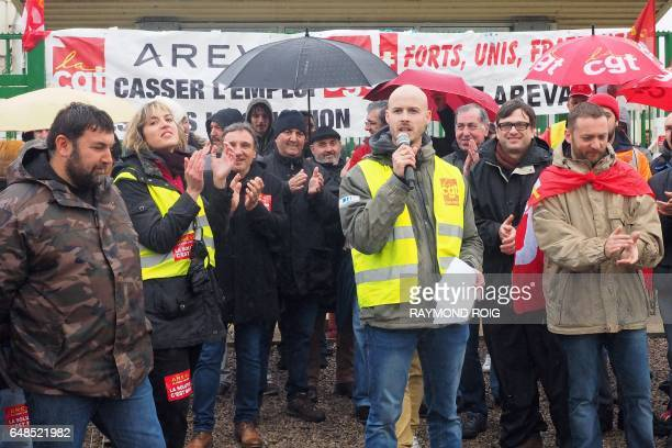 Employees listen to a speech as they block the access to the Malvesi site an uranium conversion plant of French nuclear group Areva during a protest...