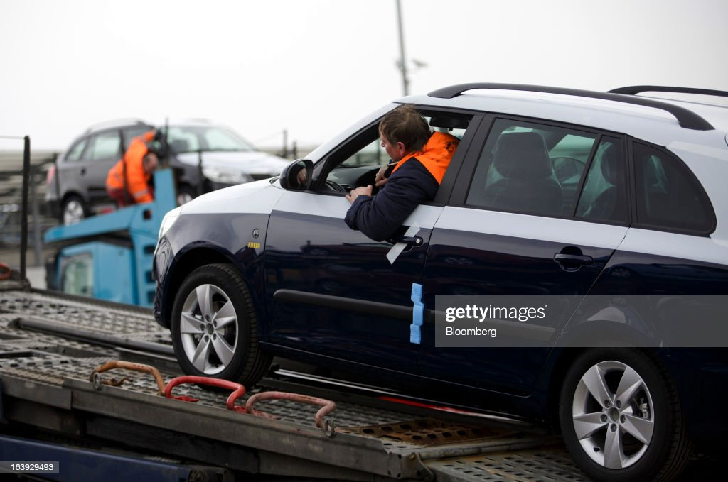 Employees load newly-manufactured Skoda automobiles onto transport trucks for distribution at the Skoda Autos AS plant in Mlada Boleslav, Czech Republic, on Friday, March 15, 2013. VW, which also owns the Porsche luxury-auto brand as well as the Skoda and Seat volume marques, will build at least 10 plants globally, including seven in China, Martin Winterkornm chief executive officer of Volkswagen AG, said. Photographer: Martin Divisek/Bloomberg via Getty Images