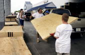 Employees load plywood sheets into a truck at a Lowe's store in Cape Coral Florida on Sunday October 23 2005 in preparation for the arrival of...
