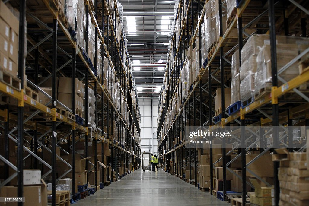 Employees look for goods in a storage aisle at the John Lewis Plc distribution centre in Milton Keynes, U.K., on Monday, Dec. 3, 2012. An index of U.K. retail sales rose to a five-month high in November, according to a monthly report from the Confederation of British Industry. Photographer: Simon Dawson/Bloomberg via Getty Images