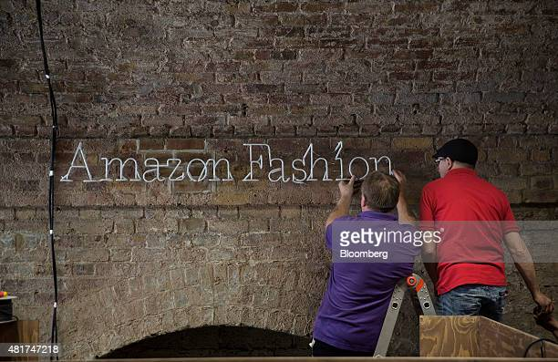 Employees make preparations for a launch party at Amazoncom Inc's new fashion photography studio in the Shoreditch district of London UK on Thursday...