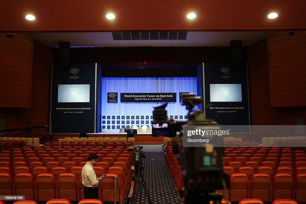 Employees make preparations in the plenary hall of the Myanmar International Convention Center ahead of the World Economic Forum on East Asia in Naypyidaw, Myanmar, on Wednesday, June 5, 2013. Myanmar hosts the three-day World Economic Forum on East Asia starting today, with heads of state and executives from companies including General Electric Co., Coca-Cola Co. and WPP Plc attending. Photographer: Dario Pignatelli/Bloomberg via Getty Images