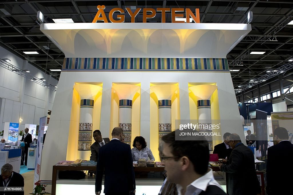 Employees man the Egypt stand at the ITB International Travel Trade Fair in Berlin March 5, 2014. The ITB opens from March 5 to 9, 2014. AFP PHOTO / JOHN MACDOUGALL