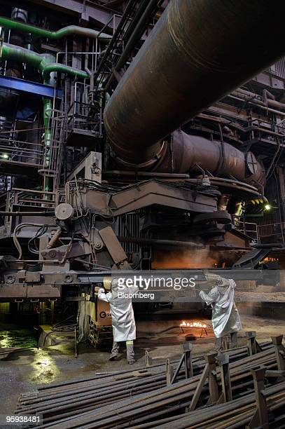 Employees monitor the blast furnace at the ArcelorMittal Ostrava steel plant in Ostrava Czech Republic on Thursday Jan 21 2010 ArcelorMittal Ostrava...