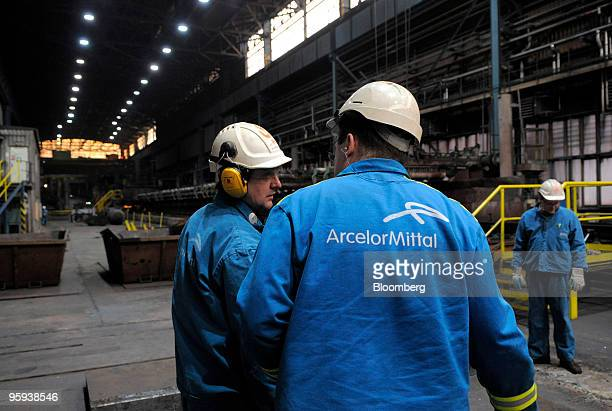 Employees monitor the flat products operation at the ArcelorMittal Ostrava steel plant in Ostrava Czech Republic on Thursday Jan 21 2010...