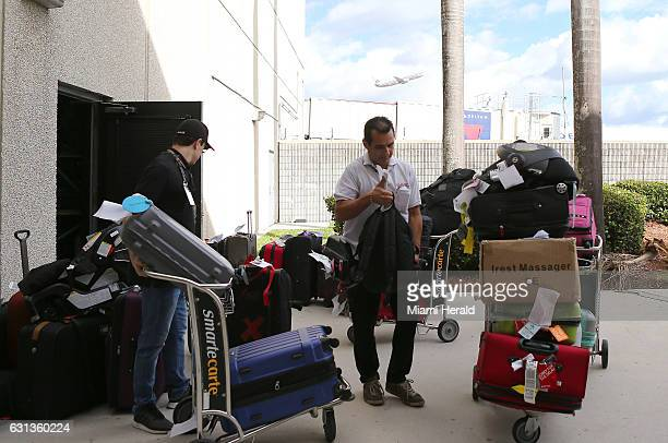 Employees moving unclaimed baggage at Fort LauderdaleHollywood International Airport in Terminal 2 on Monday Jan 9 2017
