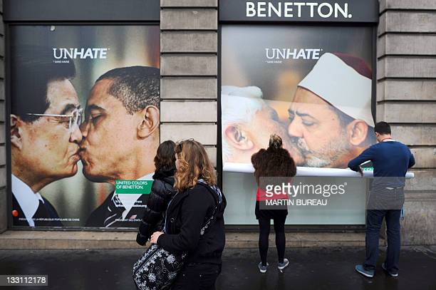 Employees of a Benetton clothing store remove a poster showing pope Benedict XVI kissing on the lips Egypt's Ahmed el Tayyeb imam of the AlAzhar...