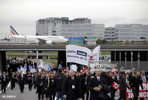 Employees of Air France demonstrate near the company headquarters during the launch of the plan at a central committee meeting in RoissyenFrance on...