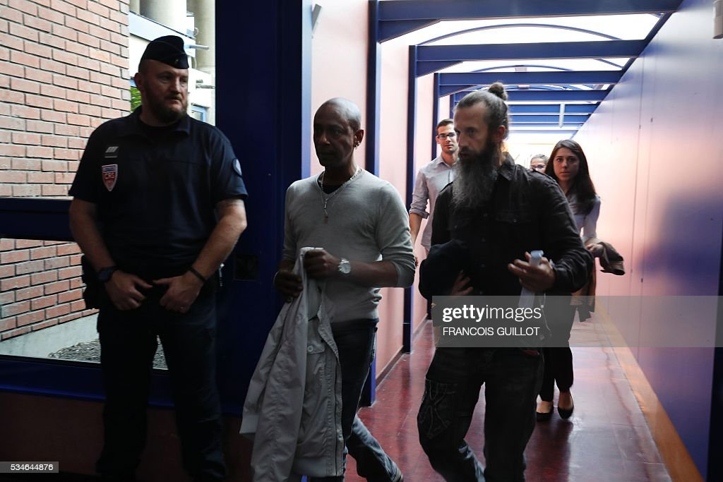 Employees of Air France get out of the audience room at the court of Bobigny, northern Paris on May 27, 2016 during the trial of 15 French CGT union's members judged for the episode of the torn shirt, in full showdown initiated by the union with the government on labor law. On October 5, 2015 under the cries of naked, naked and resignation , the Air France human resources director found himself shirtless, tattered shirt during a protest after the announcement of a restructuring of the airline threatening nearly 3,000 jobs.