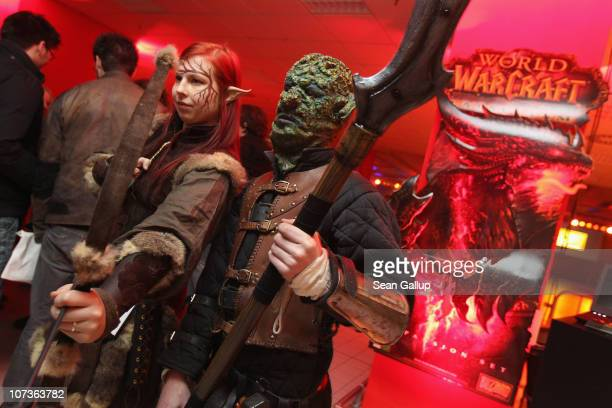 Employees of an event company dressed as 'World of Warcraft' characters pose at the global sales premiere kick off of the new 'World of Warcraft...