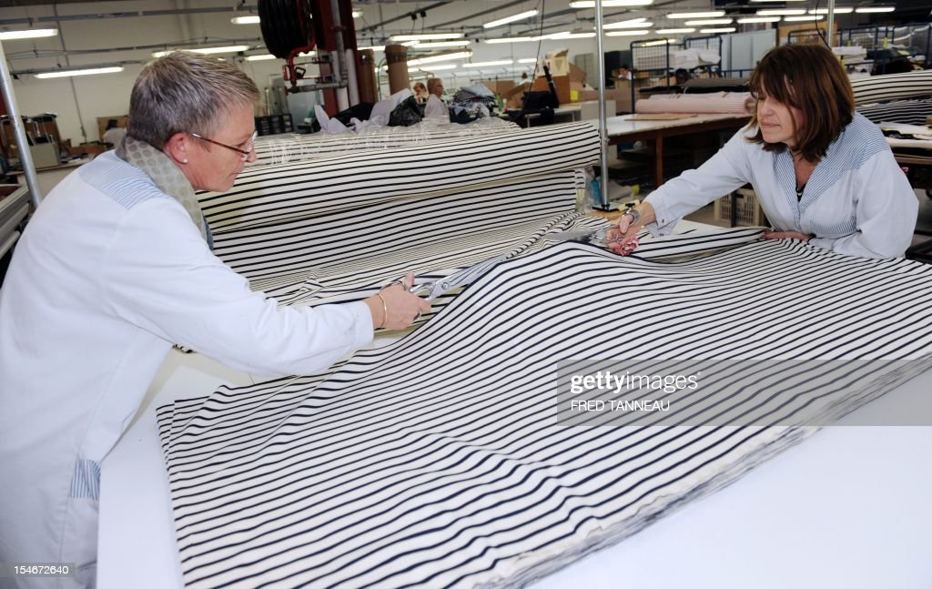 Employees of Armor Lux, specialist of the Breton style knits, works on October 24, 2012 in Quimper, western France.