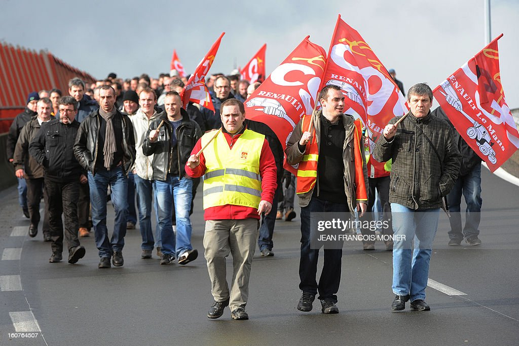 Employees of Auto Chassis International company, owned by French automaker Renault, demonstrate on the Le Mans' bypass to protest against job cuts on February 5, 2013 in Le Mans, western France.. Renault, which announced plans to cut 7,500 jobs in France through natural attrition and early retirement has pledged not to close any factories if unions agree to changes that allow the company to compete.