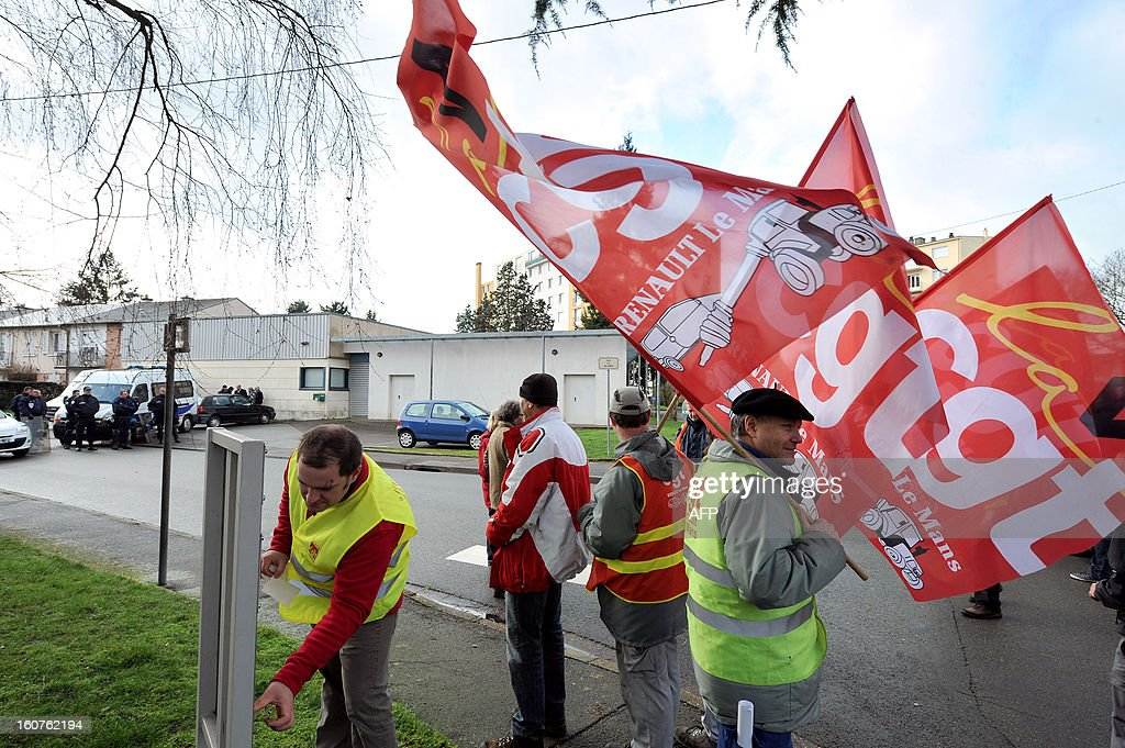 Employees of Auto Chassis International company, owned by French automaker Renault, take part in a demonstration outside the home of the French Minister of Agriculture to protest against job cuts on February 5, 2013 in Le Mans, western France. Renault, which announced plans to cut 7,500 jobs in France through natural attrition and early retirement has pledged not to close any factories if unions agree to changes that allow the company to compete.