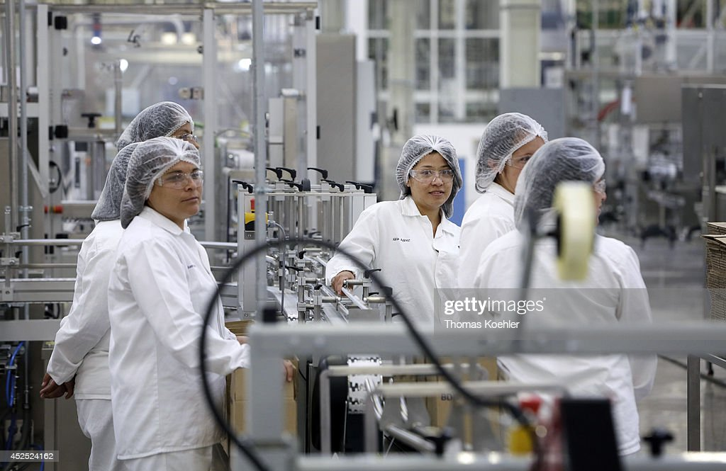 Employees of Beiersdorf in Silao in celebration of the opening of a new production hall on July 18, 2014, in Silao, Mexico. Beiersdorf AG is a German personal care company, manufacturing personal care products. Its brands include Elastoplast, Eucerin, Labello, La Prairie, Nivea and tesa SE.
