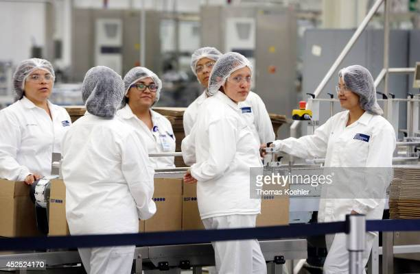 Employees of Beiersdorf in Silao in celebration of the opening of a new production hall on July 18 in Silao Mexico Beiersdorf AG is a German personal...