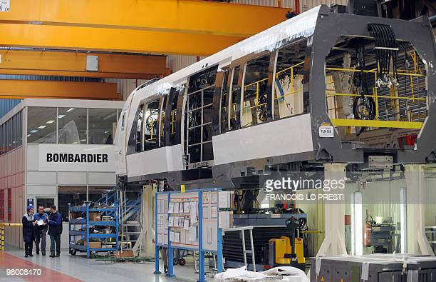 Employees of Canadian trains planes and motorized sled manufacturer Bombardier work on March 18 2010 at Crespin factory northern France AFP PHOTO /...