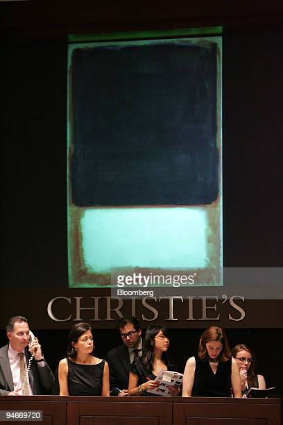Employees of Christie's International convey telephone bids on 'No 7 ' by Mark Rothko at the 'PostWar and Contemporary Art' auction in New York US on...