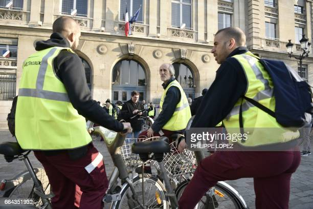 Employees of Cyclocity a branch of France's advertising group JCDecaux that maintains the 'Velib' bikesharing system gather in Place d'Italie in...