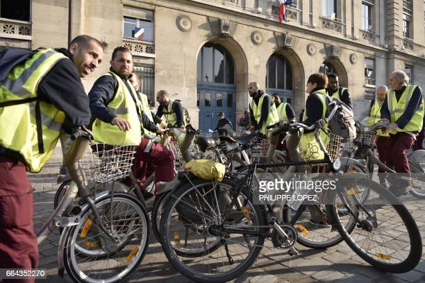 Employees of Cyclocity a branch of France's advertising group JCDecaux that maintains the 'Velib' bikesharing system gather outside the City hall of...