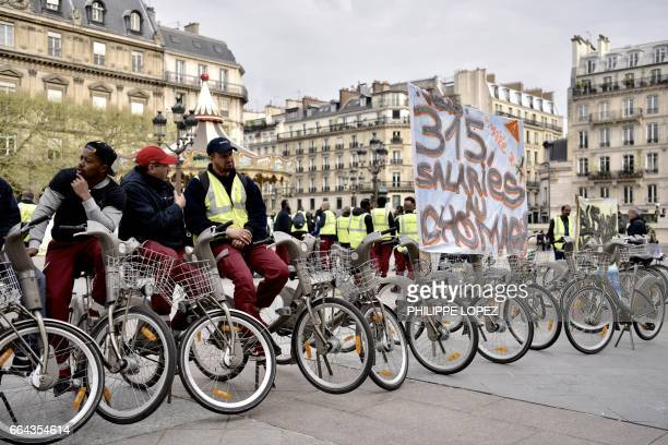 Employees of Cyclocity a branch of France's advertising group JCDecaux that maintains the 'Velib' bikesharing system gather outside the Hotel de...