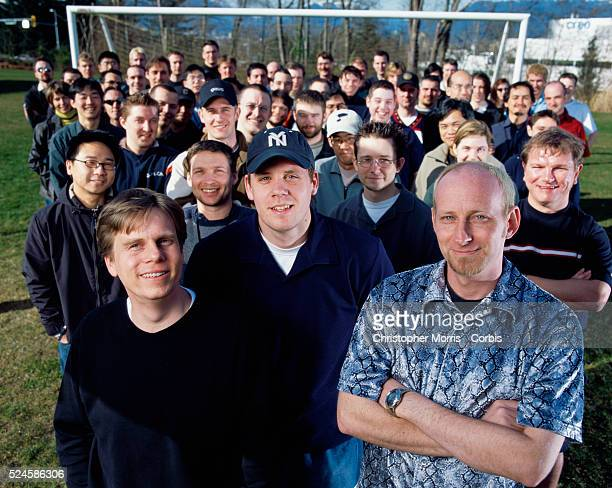 Employees of Electronic Arts video game company who make up the team which created the FIFA 2002 World Cup Soccer game for Play Station stand behind...