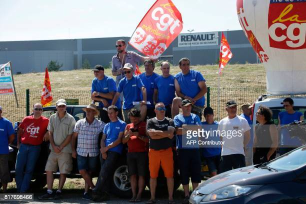 Employees of French auto parts manufacturer GMS threatened with liquidation hold CGT French union flag as they block a site of their supplier Renault...