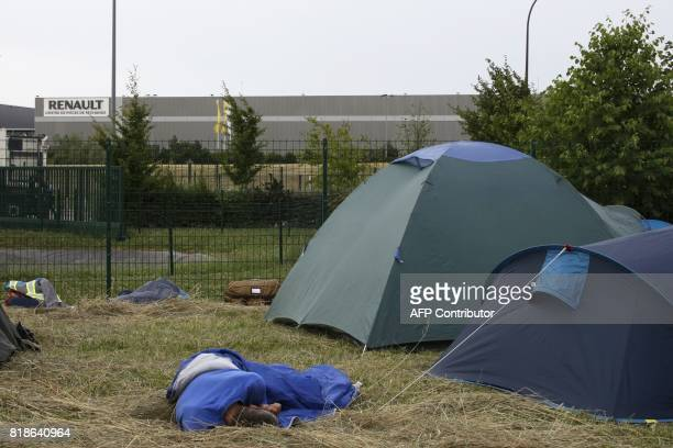 Employees of French auto parts manufacturer GMS threatened with liquidation sleep near the site of their supplier Renault on July 18 2017 in Villeroy...