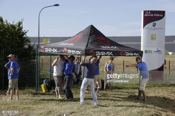 Employees of French auto parts manufacturer GMS threatened with liquidation arrive to block a site of their supplier Renault on July 18 2017 in...