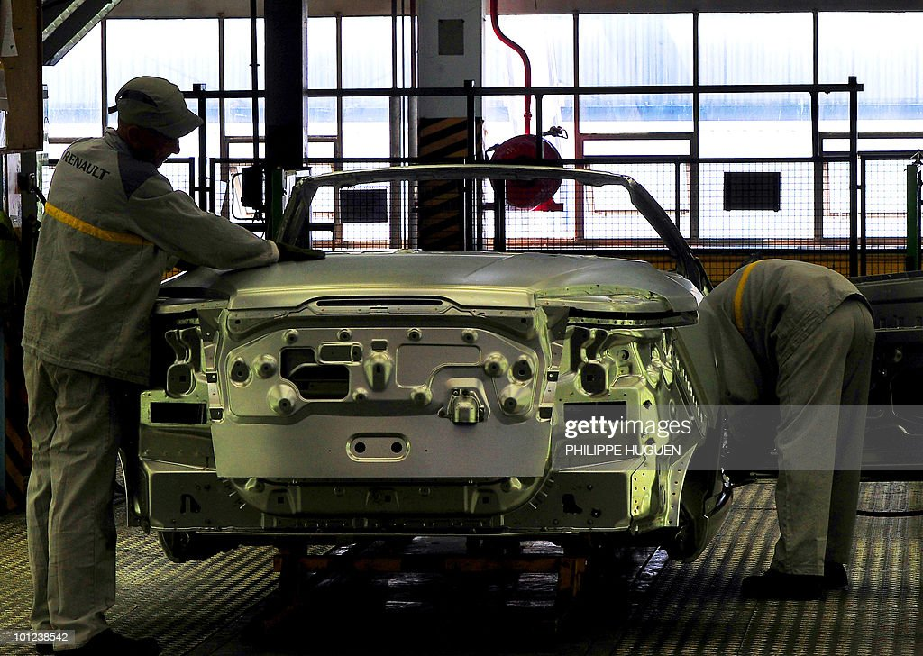 Employees of French carmaker Renault are at work on the assembly line at a Renault factory in on May 25, 2010 in Douai, northern France.