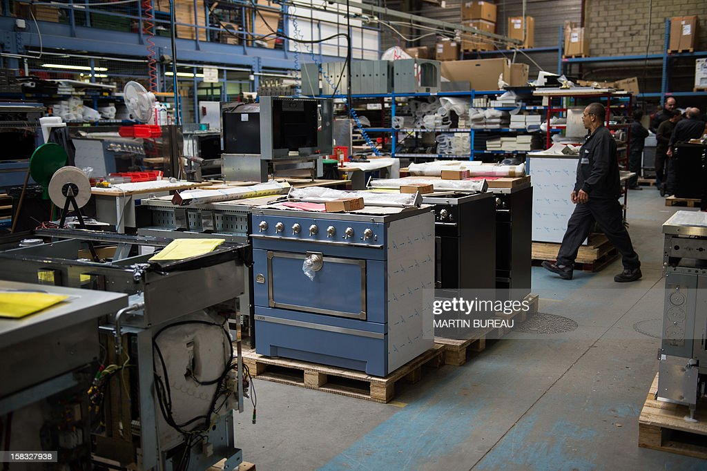 Employees of French cooker maker 'La Cornue' work in the factory on December 13, 2012, in Saint-Ouen-l'Aumone, north of Paris.
