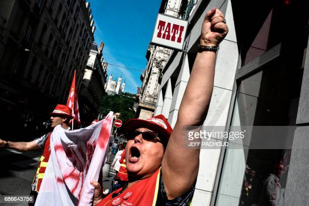 Employees of French department store Tati shout slogans during a demonstration in front of a Tati store on May 22 2017 in Lyon Five companies...
