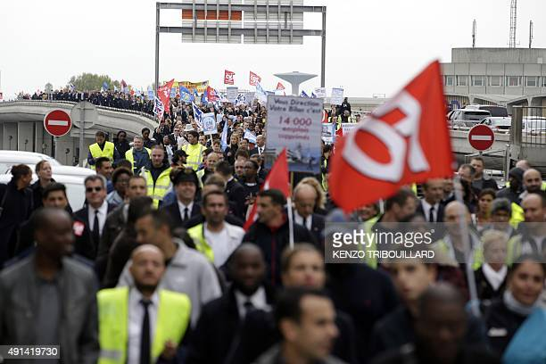 Employees of French flag carrier Air France demonstrate near the company headquarters during the launch of the plan at a central committee meeting in...