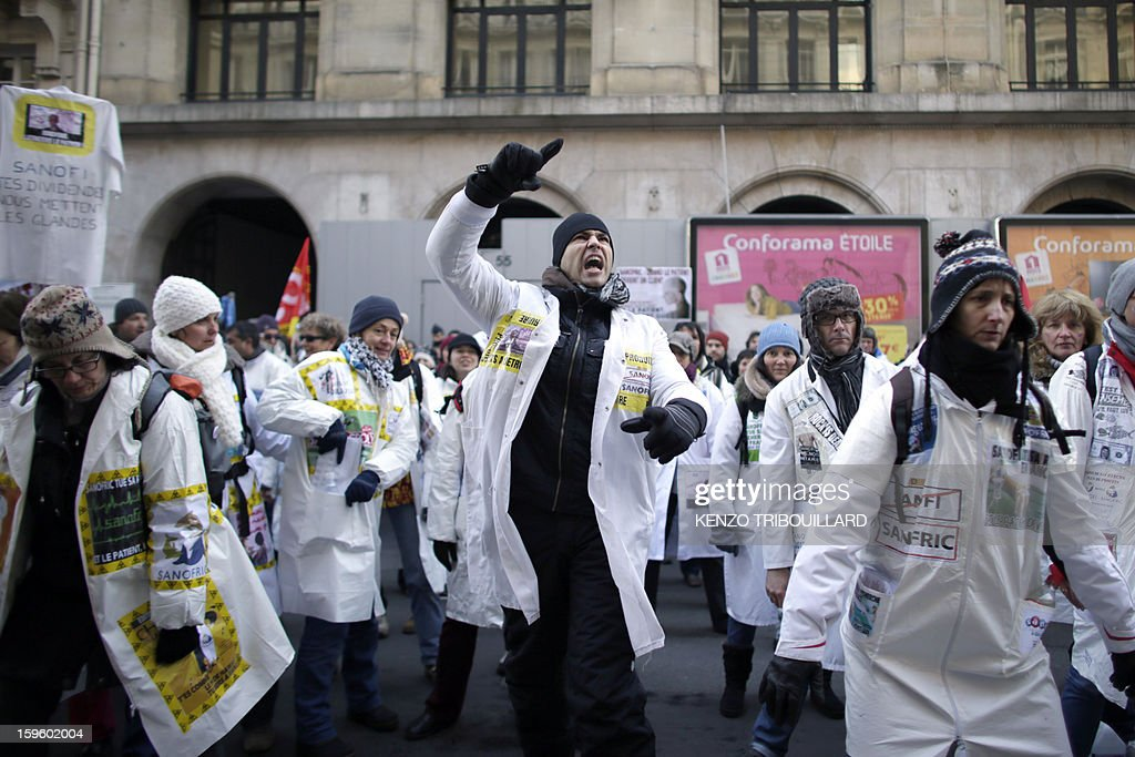 Employees of French pharmaceutical group Sanofi take part in a demonstration, on January 17, 2013 in Paris, to protest against the Sanofi's plan to 900 cut jobs in France by the end of 2015.