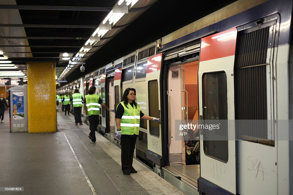 Employees of French transport group RATP are pictured on an empty platform at Chatelet suburban train railway station on September 7, 2010 in Paris, during a National one-day of action against a government pension reform bill. French President Nicolas Sarkozy's government faces a showdown with angry trade unions Today as thousands prepared to march against plans to raise the minimum retirement age to 62.
