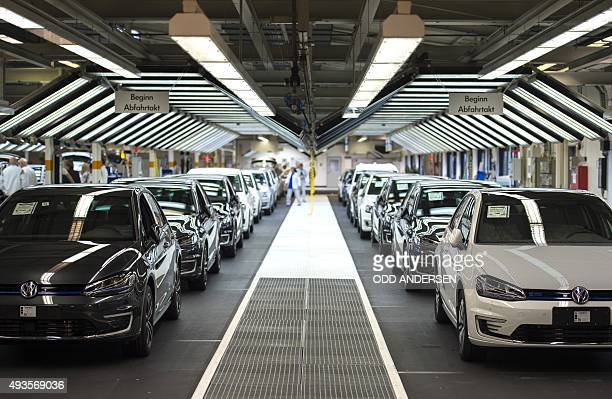 Employees of German car maker Volkswagen check cars at a assembly line of the VW plant in Wolfsburg central Germany on October 21 2015 Volkswagen...