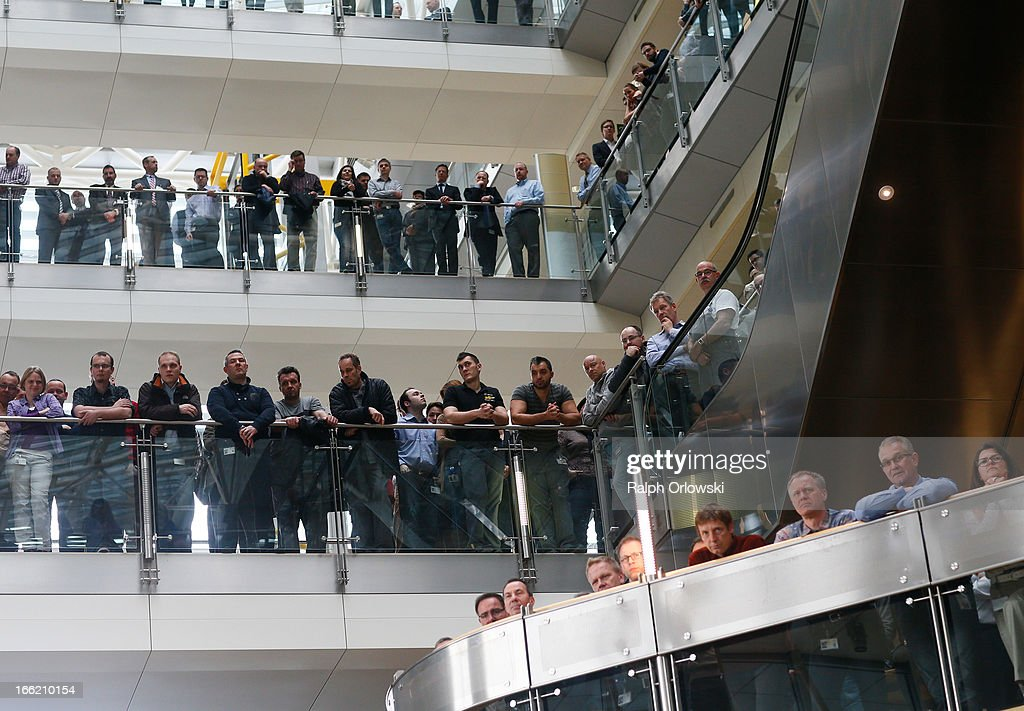 Employees of German carmaker Opel listen to a press conference held by the Opel management at Opel headquarters on April 10 2013 in Ruesselsheim...