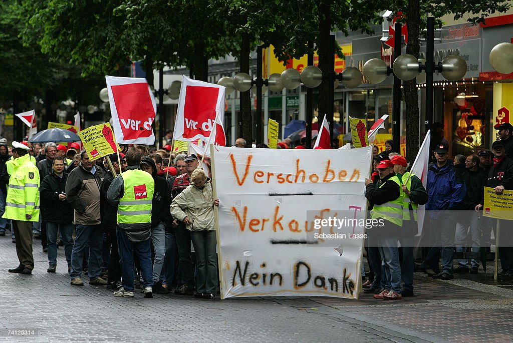 Employees of German telecommunications giant Deutsche Telekom demonstrate against their company's policy on May 11 2007 in the city of Hagen Germany...